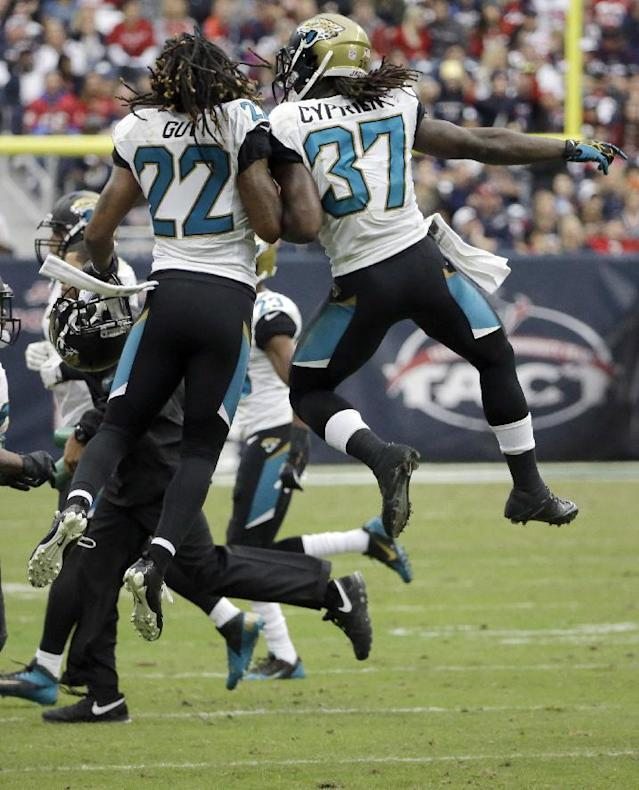 The Jacksonville Jaguars, including Winston Guy (22) Johnathan Cyprien (37) and Roy Miller (97) celebrate after stopping the Houston Texans on fourth down. during the fourth quarter of an NFL football game Sunday, Nov. 24, 2013, in Houston. (AP Photo/David J. Phillip)