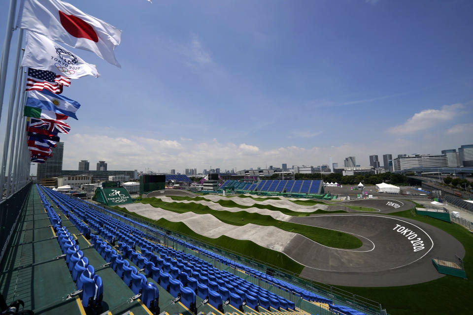 The BMX racing track is seen from the top of the grandstands as preparations continue for the 2020 Summer Olympics, Tuesday, July 20, 2021, at the Ariake Urban Sports Park in Tokyo. The pandemic-delayed games open on July 23 without spectators at most venues. (AP Photo/Charlie Riedel)