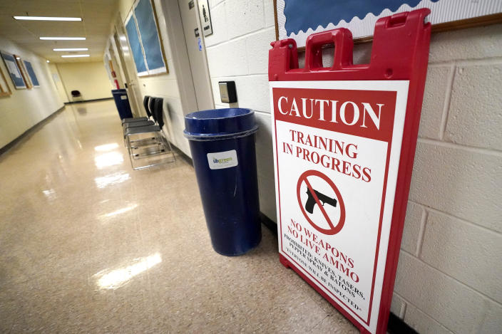 In this Sept. 9, 2020, photo a sign is seen in the hallway near classrooms where Baltimore Police Academy cadets attend classes in Baltimore. (AP Photo/Julio Cortez)