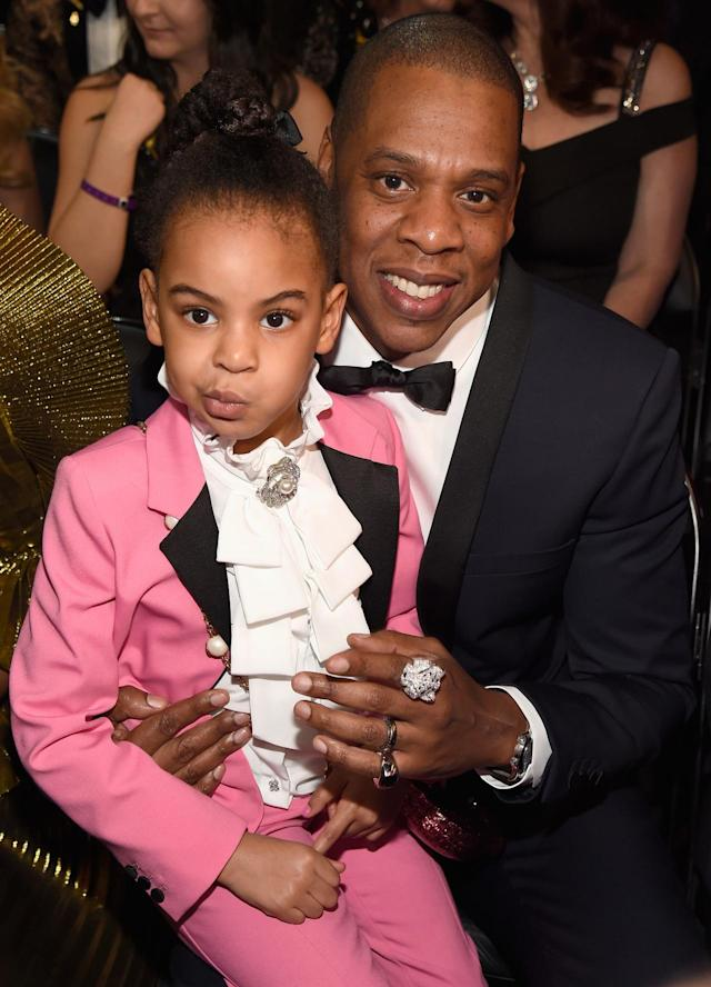 "<p>Blue, wearing her best unimpressed face, was also at the Grammys last year — on daddy's knee. The pretty in pink tot sat with Jay and auntie Solange and took in her mama's memorable performance. The show aired later that year — in mid-February — and <a href=""https://www.yahoo.com/entertainment/beyonce-is-pregnant-with-twins-190514308.html"" data-ylk=""slk:Bey had announced her pregnancy;outcm:mb_qualified_link;_E:mb_qualified_link"" class=""link rapid-noclick-resp newsroom-embed-article"">Bey had announced her pregnancy</a>, with twins, days earlier. She was all maternal up on stage — and had the best cheering section. Clearly. Blue also <a href=""https://www.yahoo.com/entertainment/beyonc-grammys-2017-performance-features-020500963.html"" data-ylk=""slk:appeared in a video opening Bey's set;outcm:mb_qualified_link;_E:mb_qualified_link"" class=""link rapid-noclick-resp newsroom-embed-article"">appeared in a video opening Bey's set</a>. Where will she turn up next? (Photo: Kevin Mazur/Getty Images for NARAS) </p>"