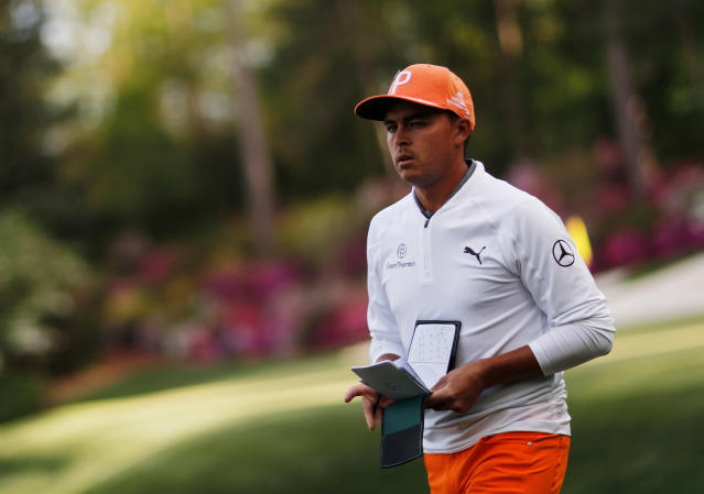 Rickie Fowler walks to the 14th tee during the fourth round at the Masters golf tournament Sunday, April 8, 2018, in Augusta, Ga. (AP Photo/David Goldman)