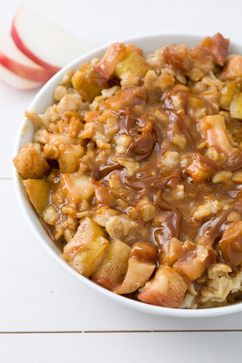 """<p>Yes, we love apple pie so much we turned it into porridge. Drizzled with caramel, it's a breakfast you won't forget.</p><p>Get the <a href=""""https://www.delish.com/uk/cooking/recipes/a29016955/caramel-apple-pie-oatmeal-recipe/"""" rel=""""nofollow noopener"""" target=""""_blank"""" data-ylk=""""slk:Caramel Apple Pie Porridge"""" class=""""link rapid-noclick-resp"""">Caramel Apple Pie Porridge</a> recipe.</p>"""