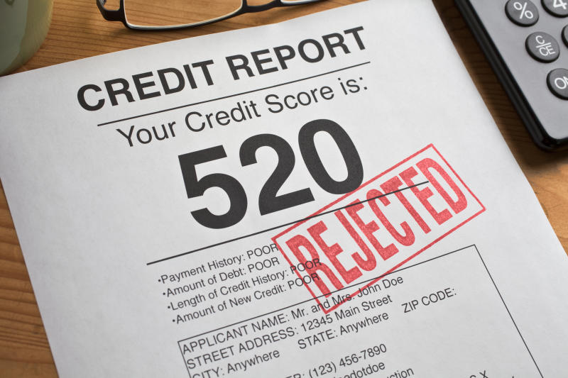 """Credit report with """"rejected"""" stamp."""