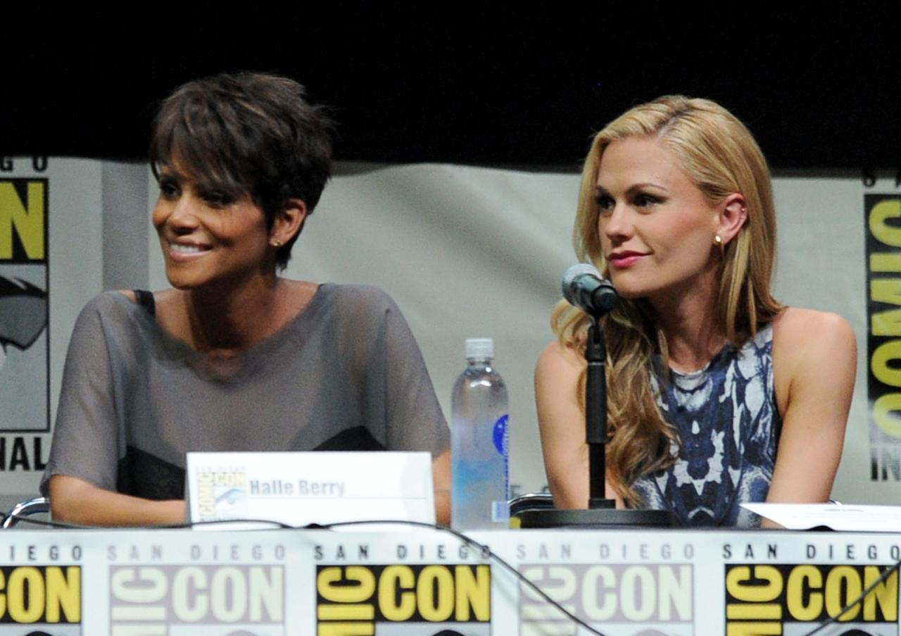 SAN DIEGO, CA - JULY 20: Actresses Halle Berry (L) and Anna Paquin speak at the 20th Century Fox panel during Comic-Con International 2013 at San Diego Convention Center on July 20, 2013 in San Diego, California. (Photo by Kevin Winter/Getty Images)