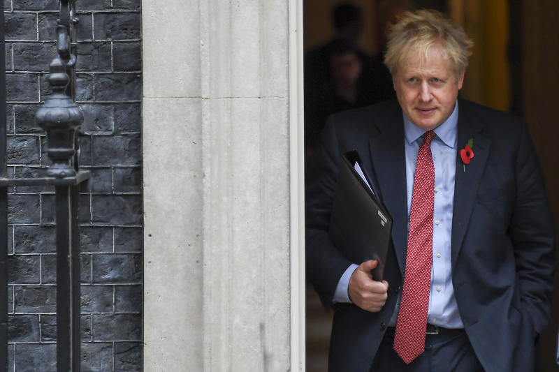 Britain's Prime Minister Boris Johnson leaves 10 Downing Street on his way to the Houses of Parliament in London, Tuesday, Oct. 29, 2019. Britain appeared on course Tuesday for an early general election that could break the country's political deadlock over Brexit, after the main opposition Labour Party said it would agree to the government's request to send voters to the polls in December. (AP Photo/Alberto Pezzali)