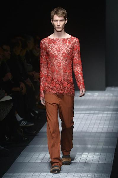 A model wears a lace top from the latest Gucci Fall/Winter 2015 collection