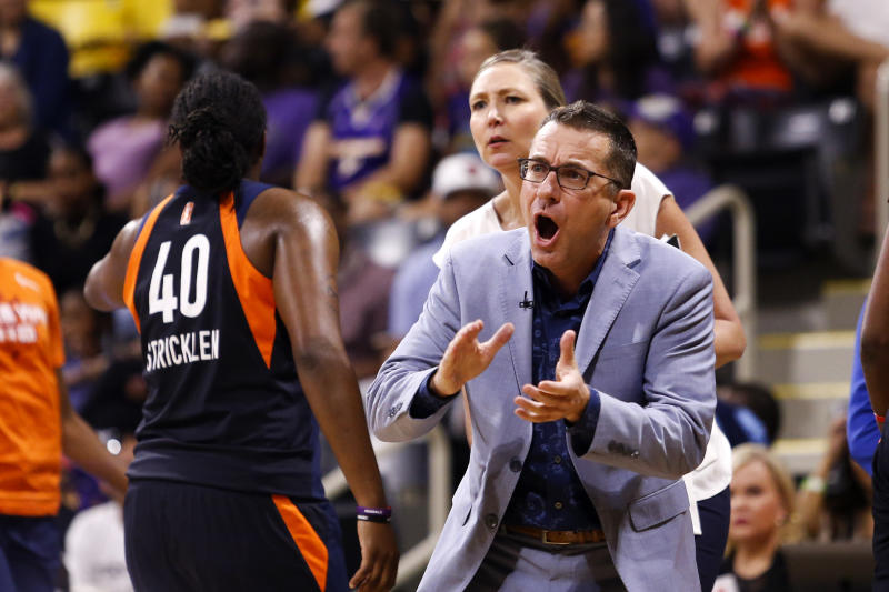 Connecticut Sun's head coach Curt Miller, right, greets his players during a timeout in the second half of Game 3 of a WNBA basketball playoff game against the Los Angeles Sparks, Sunday, Sept. 22, 2019, in Long Beach, Calf. (AP Photo/Ringo H.W. Chiu)