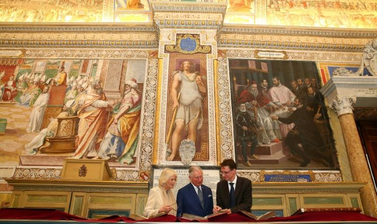 Britain's Prince Charles (C) and his wife Camilla, Duchess of Cornwall visit the Vatican Apostolic Library