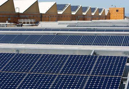 Solar panels sit on the roof of SunPower Corporation in Richmond