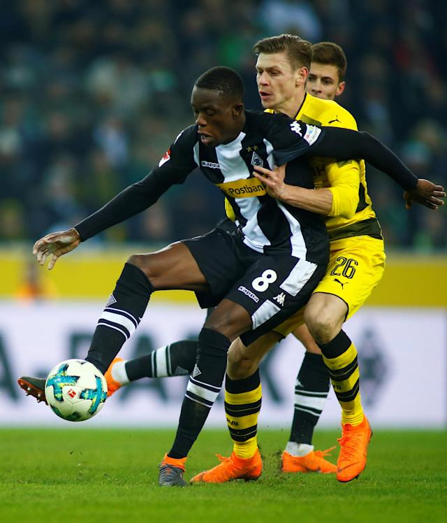 Soccer Football - Bundesliga - Borussia Moenchengladbach vs Borussia Dortmund - Borussia-Park, Moenchengladbach, Germany - February 18, 2018 Borussia Monchengladbach's Denis Zakaria in action with Borussia Dortmund's Lukasz Piszczek REUTERS/Thilo Schmuelgen DFL RULES TO LIMIT THE ONLINE USAGE DURING MATCH TIME TO 15 PICTURES PER GAME. IMAGE SEQUENCES TO SIMULATE VIDEO IS NOT ALLOWED AT ANY TIME. FOR FURTHER QUERIES PLEASE CONTACT DFL DIRECTLY AT + 49 69 650050