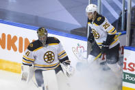 Boston Bruins goaltender Jaroslav Halak takes part in a pre-game skate ahead of game three of NHL first round Stanley Cup playoff game against the Carolina Hurricanes, in Toronto on Saturday, Aug. 15, 2020. (Chris Young/The Canadian Press via AP)