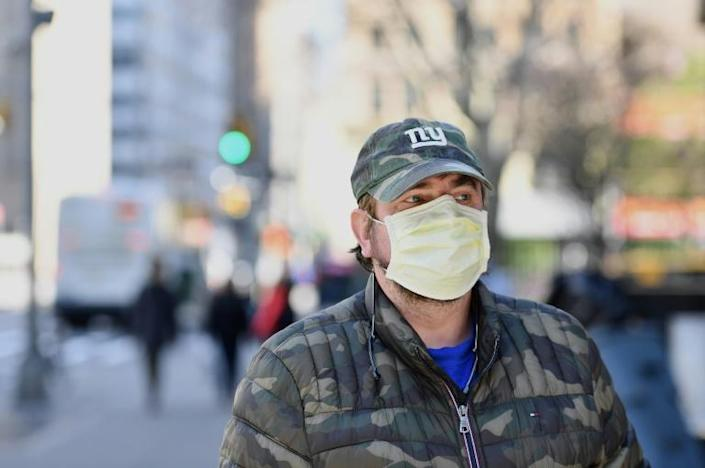 A man wearing a face mask walks in New York on March 18 (AFP Photo/Angela Weiss)