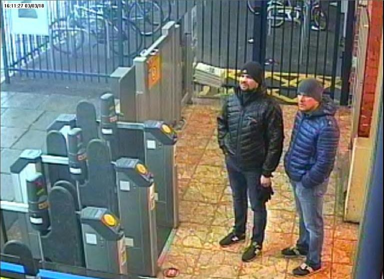 Picture taken at Salisbury train station and released by the Metropolitan Police shows Alexander Petrov (R) and Ruslan Boshirov, suspects in the nerve agent attack on former Russian spy Sergei Skripal and his daughter Yulia