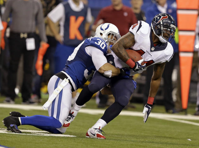 Indianapolis Colts strong safety LaRon Landry, left, tackles Houston Texans running back Ben Tate during the second half of an NFL football game in Indianapolis, Sunday, Dec. 15, 2013. (AP Photo/Darron Cummings)