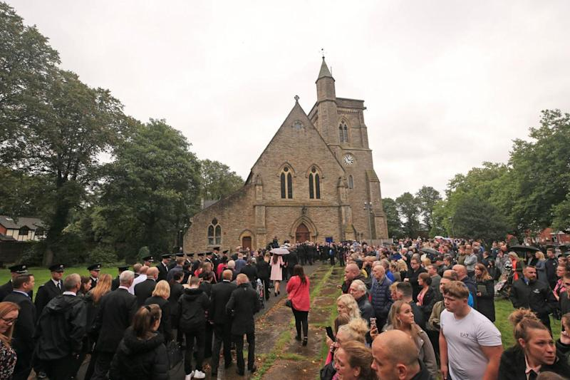 Four little coffins were carried into church for the children's funerals (Peter Byrne/PA)