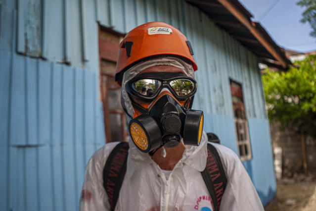 An officer is pictured preparing to spray disinfectants in a residential area in Palu City on 23 March. Indonesia has had 579 confirmed cases. (Getty Images)