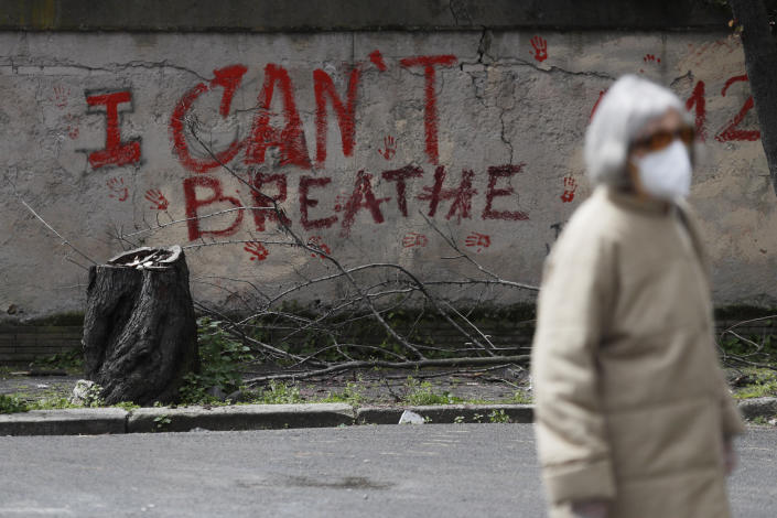 """A graffiti reading """"I Can't Breathe"""" is seen on a wall in Rome, Wednesday, April 21, 2021. After three weeks of testimony, the trial of the former police officer charged with killing George Floyd ended swiftly: barely over a day of jury deliberations, then just minutes for the verdicts to be read — guilty, guilty and guilty — and Derek Chauvin was handcuffed and taken away to prison. The guilty verdict in the George Floyd trial was not just America's victory. It signaled hope for those seeking racial justice and fighting police brutality across the Atlantic. (AP Photo/Gregorio Borgia)"""