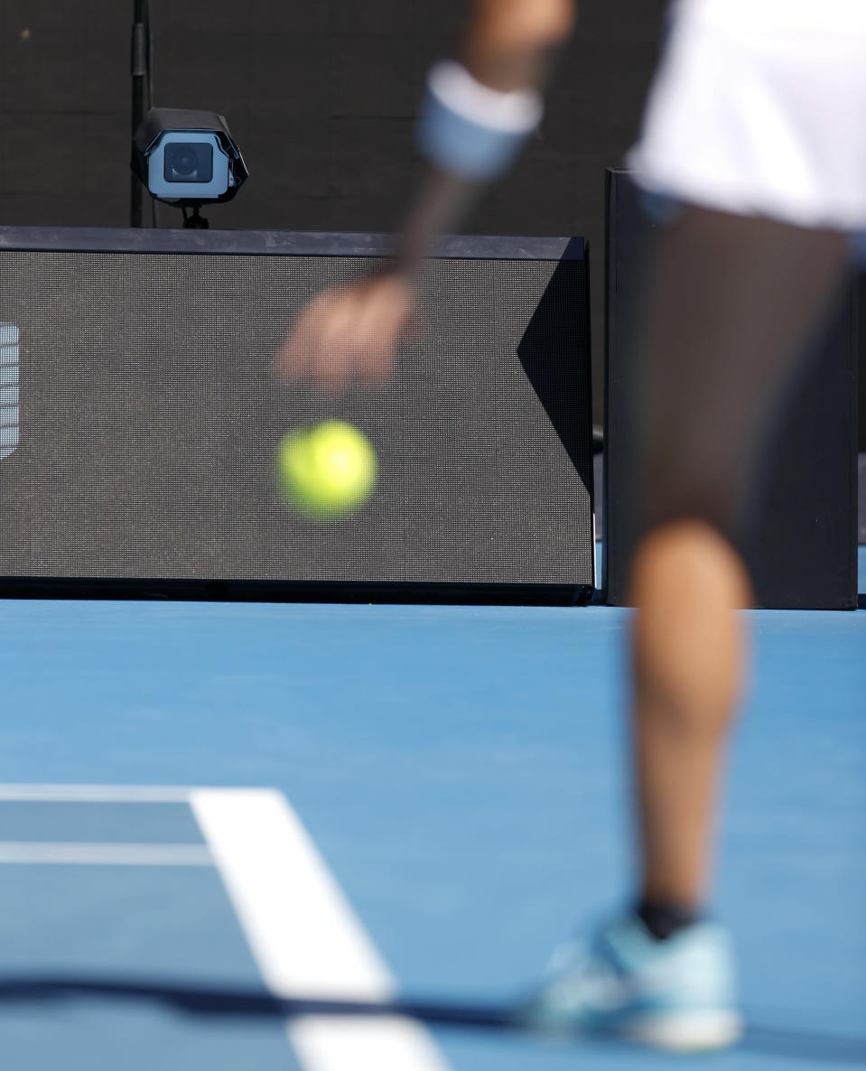 A line camera films as Taiwan's Hsieh Su-Wei prepares to serve to Canada's Bianca Andreescu during their second round match at the Australian Open tennis championship in Melbourne, Australia, Wednesday, Feb. 10, 2021. Eliminating all line judges and removing the human element from officiating at the Australian Open might have been a necessary step to reduce the number of people on court amid a pandemic. It also might be good for the integrity of the game, because getting every call right matters so much to players and fans. (AP Photo/Rick Rycroft)
