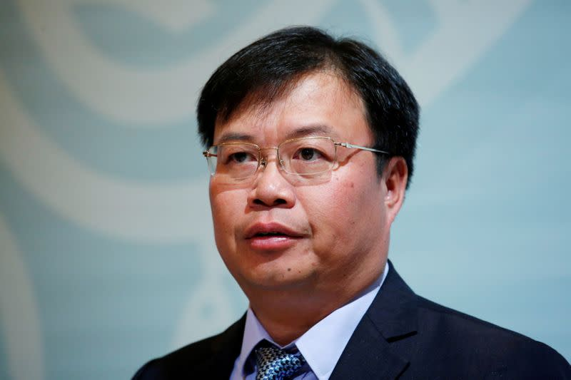 Country Garden Holdings President and Executive Director Mo Bin attends a news conference in Hong Kong