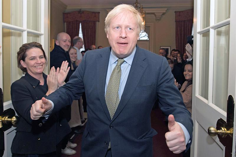 Prime Minister Boris Johnson is greeted by staff as he arrives back at 10 Downing Street, London, after meeting Queen Elizabeth II and accepting her invitation to form a new government after the Conservative Party was returned to power in the General Election with an increased majority.