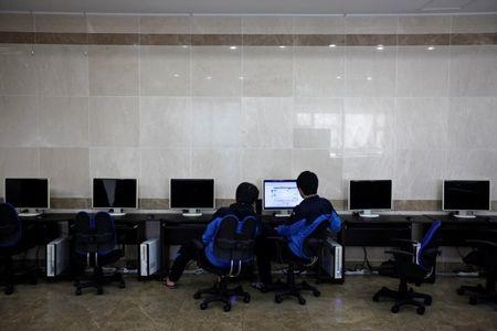 File photo of students retaking the college entrance exams using a public computer during recess at a school in Kwangju