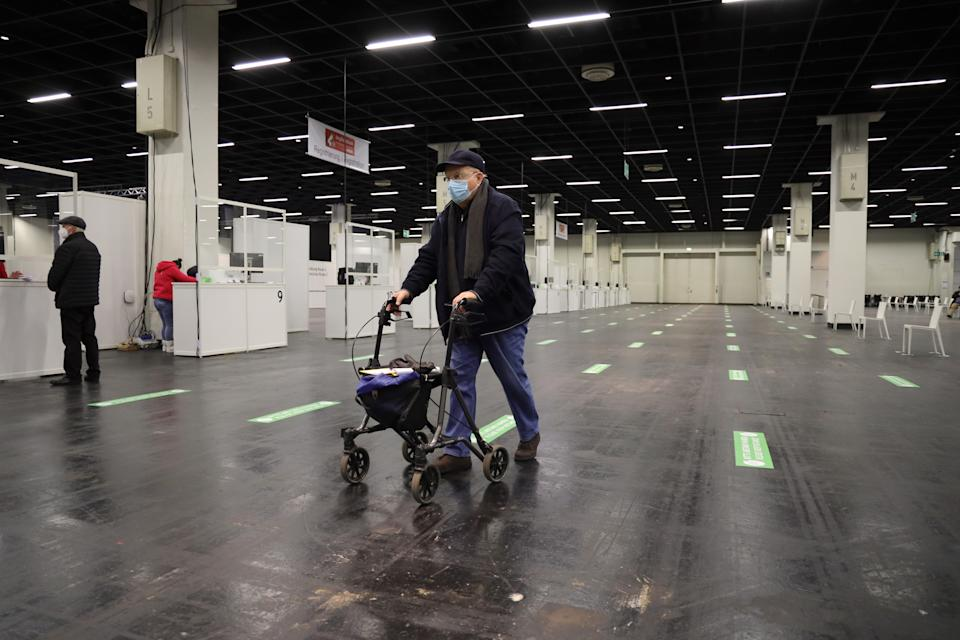 COLOGNE, GERMANY - FEBRUARY 08:  A senior citizen queues up to register and following up with a vaccination against COVID-19 at a vaccine center built in a hall of the Koeln Messe trade fair grounds during the second wave of the coronavirus pandemic on February 08, 2021 in Cologne, Germany. The 53 vaccine centers across North Rhine-Westphalia are opening their doors today to administer vaccines, mostly against people over 80 years old. Germany has experienced a hampered vaccine rollout due to production setbacks for all three of the vaccine so far approved in the European Union. (Photo by Andreas Rentz/Getty Images)