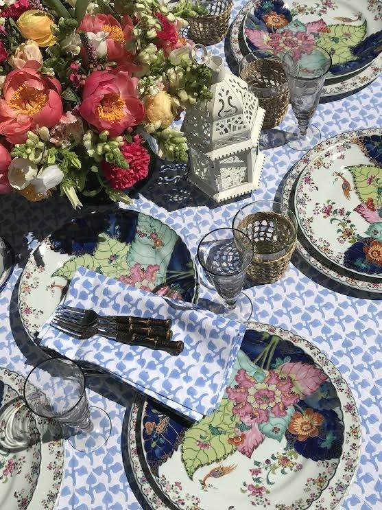 Mottahedeh's well-known Tobacco Leaf plates offset Amory's Big Sky tablecloth and napkins.