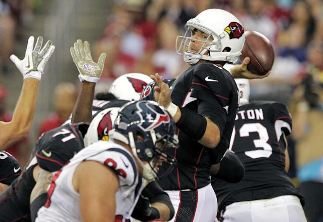 Arizona Cardinals quarterback Carson Palmer, right, throws under pressure against the Houston Texans during the first half of an NFL football game Sunday, Nov. 10, 2013, in Glendale, Ariz. (AP Photo/Rick Scuteri)