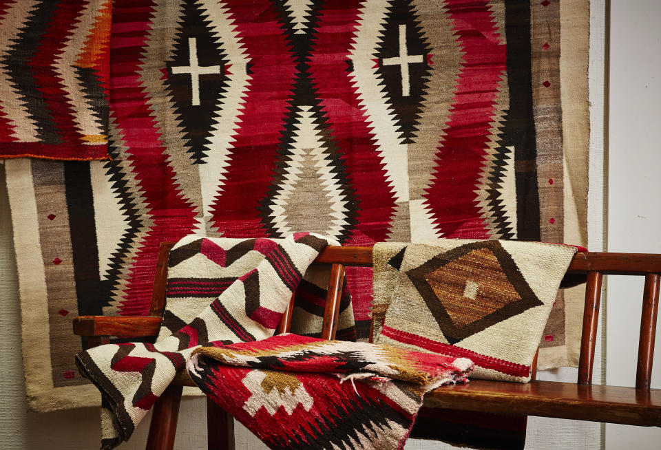 """This photo provided by Upstate Rug Supply shows a selection of Navajo rugs. """"The Navajo are among the finest rug makers in the world, featuring loom work and design on par with the best Persian rugs,"""" says Atlanta-based design editor Leanne Potts. """"These Southwestern masterpieces feature designs and colors that work with many decor styles."""" Joanna Mahserdjian, founder of Upstate Rug Supply in Hudson, NY, agrees. """"Hang one on the wall as art, place one on the floor in a mid-century modern home, or layer them with Persian rugs- as Ralph Lauren does. (Christian Harder/Upstate Rug Supply via AP)"""