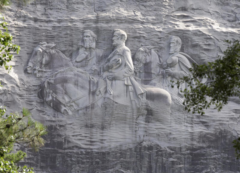 A carving depicting Confederate icons Stonewall Jackson, Robert E. Lee and Jefferson Davis, in Stone Mountain, Ga.