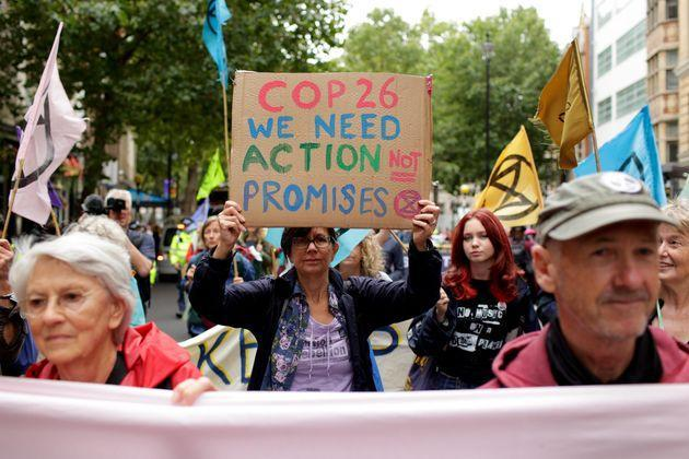 Members of climate change activist movement Extinction Rebellion march along Charing Cross Road on August 23, 2021 (Photo: Anadolu Agency via Getty Images)