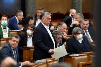 FILE PHOTO: Hungarian Prime Minister Viktor Orban arrives to the plenary session of the Parliament ahead of a vote to grant the government special powers to combat the coronavirus crisis in Budapest