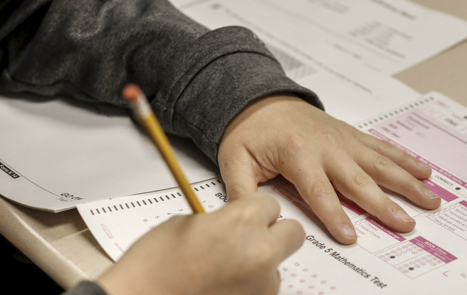 Hands of a student are shown with pencil and test booklet during New York State math test on May 2, 2017. (Photo by John Paraskevas/Newsday RM via Getty Images)