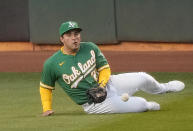 Oakland Athletics center fielder Ramon Laureano can't make the catch on a single by Houston Astros' Myles Straw during the second inning of a baseball game Friday, April 2, 2021, in Oakland, Calif. (AP Photo/Tony Avelar)