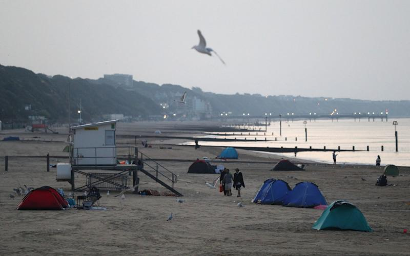 Tents pitched up on Bournemouth beach in Dorset. PA Photo - PA