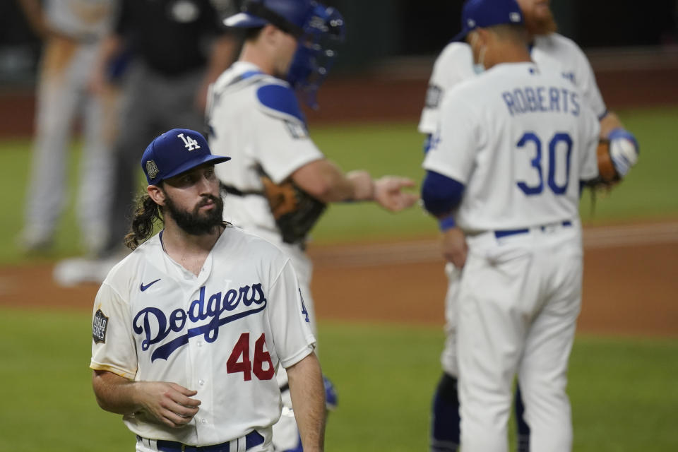 Los Angeles Dodgers starting pitcher Tony Gonsolin leaves the game against the Tampa Bay Rays during the second inning in Game 2 of the baseball World Series Wednesday, Oct. 21, 2020, in Arlington, Texas. (AP Photo/Eric Gay)
