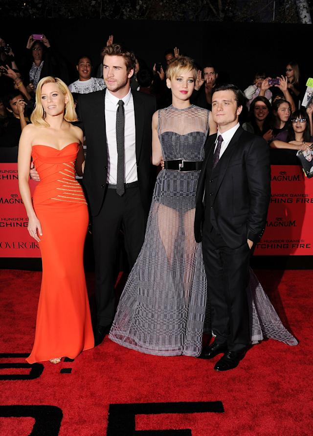 """<p>Lawrence wows at the premiere of <i>The Hunger Games: Catching Fire</i> with a new pixie cut and sheer dress. Here she poses with (left to right) co-stars <a href=""""https://www.yahoo.com/entertainment/tagged/elizabeth-banks"""" data-ylk=""""slk:Elizabeth Banks"""" class=""""link rapid-noclick-resp"""">Elizabeth Banks</a>, Hemsworth, and Hutcherson. (Photo: Getty Images) </p>"""