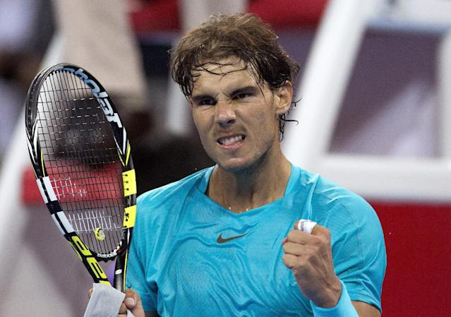 Rafael Nadal of Spain celebrates after winning over Santiago Giraldo of Colombia during their match in the China Open tennis tournament at the National Tennis Stadium in Beijing, China Tuesday, Oct. 1, 2013. (AP Photo/Andy Wong)