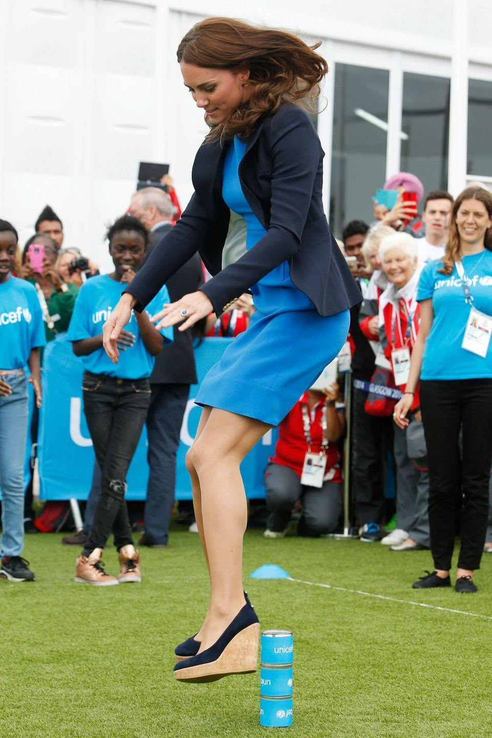 "<p>The Duchess does it all. In Scotland, she plays a South African game of ""Three Tins"" while wearing heels. </p>"