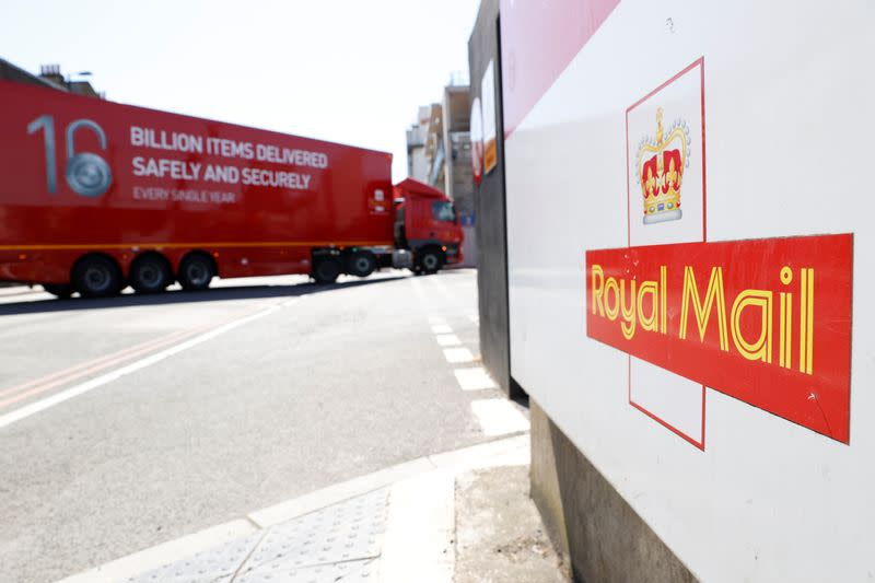 The logo of Royal Mail is seen outside the Mount Pleasant Sorting Office as a delivery vehicle arrives, in London