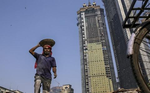 Trump Tower Mumbai are one of four luxury apartment projects underway in India  - Credit: Dhiraj Singh/ Bloomberg