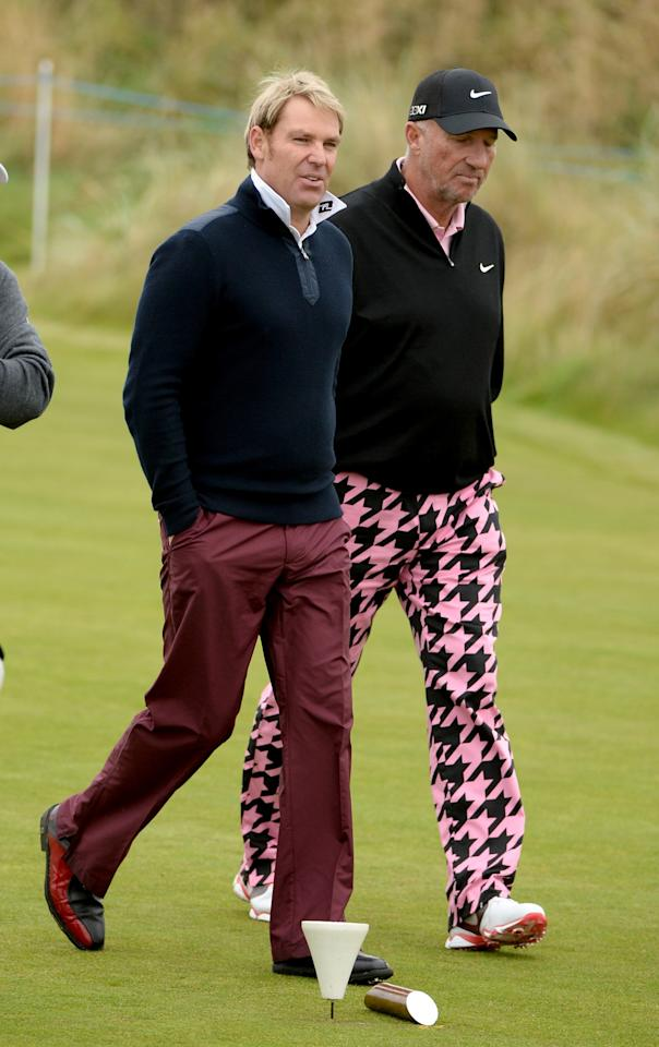 KINGSBARNS, SCOTLAND - SEPTEMBER 24: Shane Warne (L) and Sir Ian Botham on the third hole during a practice round of the Alfred Dunhill Links Championship on the Kingsbarns Golf Links at Kingsbarns on September 24, 2013 in Kingsbarns, Scotland. (Photo by Ross Kinnaird/Getty Images)
