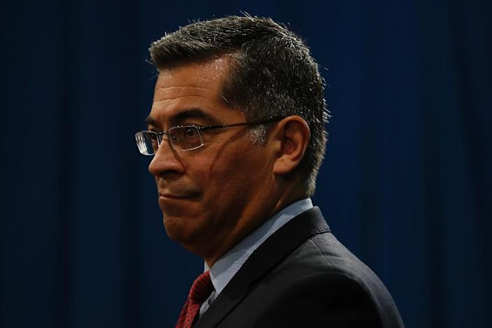 A group of Democratic attorneys general led by Xavier Becerra of California scoff at the idea that a change in the tax law would invalidate the whole Affordable Care Act (AFP Photo/Stephen Lam)