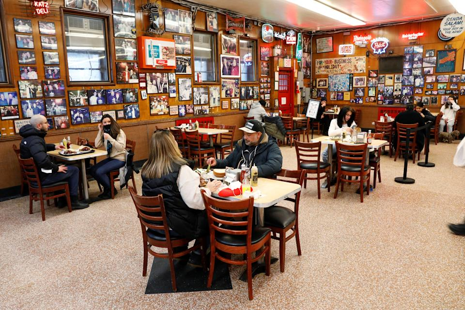 Patrons enjoy lunch at Katz's Delicatessen, the famous deli founded in 1888, on the first day of the return to indoor dining for New York City, during the coronavirus disease (COVID-19) pandemic, in New York U.S., February 12, 2021.  REUTERS/Brendan McDermid