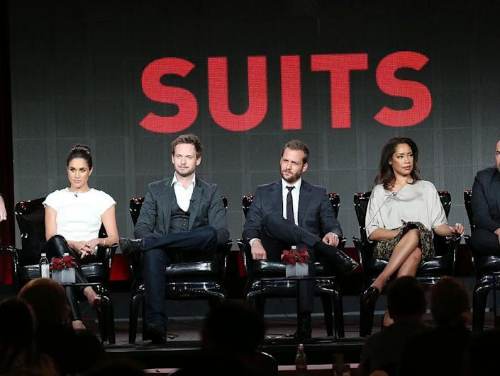 Meghan pictured alongside the cast of Suits (Getty Images)