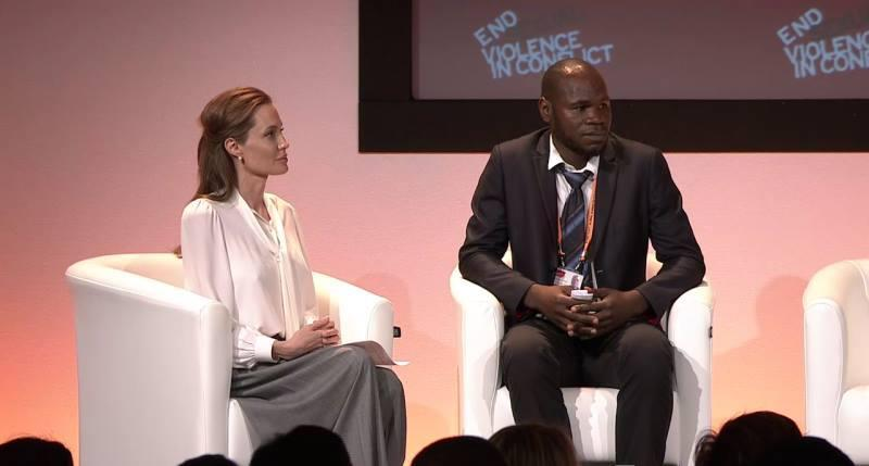 Kolbassia Haoussou with Angelina Jolie at the Global Summit to End Sexual Violence in Conflict in 2014 (Freedom From Torture/PA)