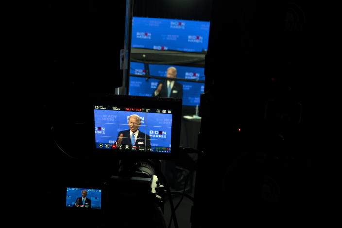 FILE - In this Aug. 12, 2020, file photo Democratic presidential candidate former Vice President Joe Biden is seen on monitors as he speaks during a virtual grassroots fundraiser at the Hotel DuPont in Wilmington, Del. As Democrats gather virtually this week to nominate Joe Biden for the presidency, party leaders and activists across the political spectrum agree on one unifying force: their desire to defeat President Donald Trump. (AP Photo/Carolyn Kaster, File)