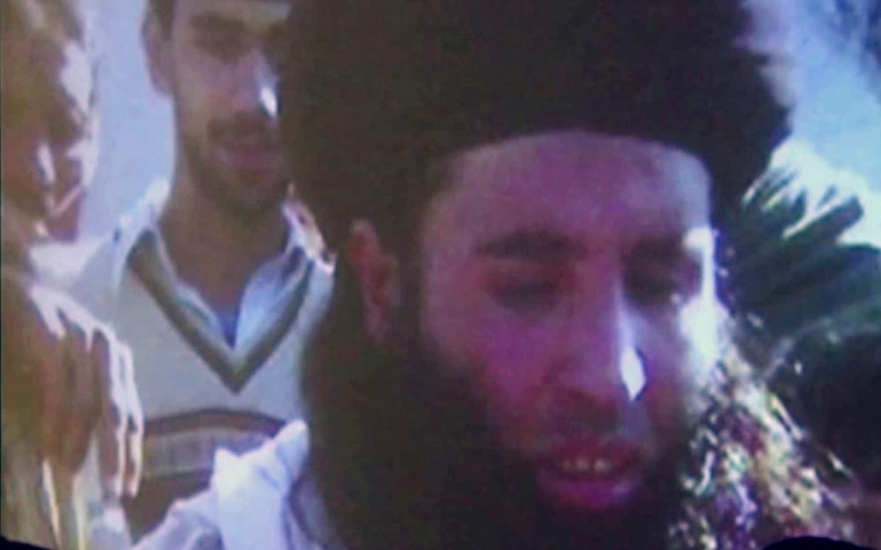 Undated footage of Mullah Fazlullah is shown on a projector - AP Video