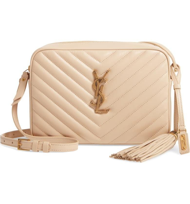 <p>The cream color of the <span>Saint Laurent Lou Matelassé Leather Camera Bag</span> ($1,250) makes it easy to pair with any outfit.</p>