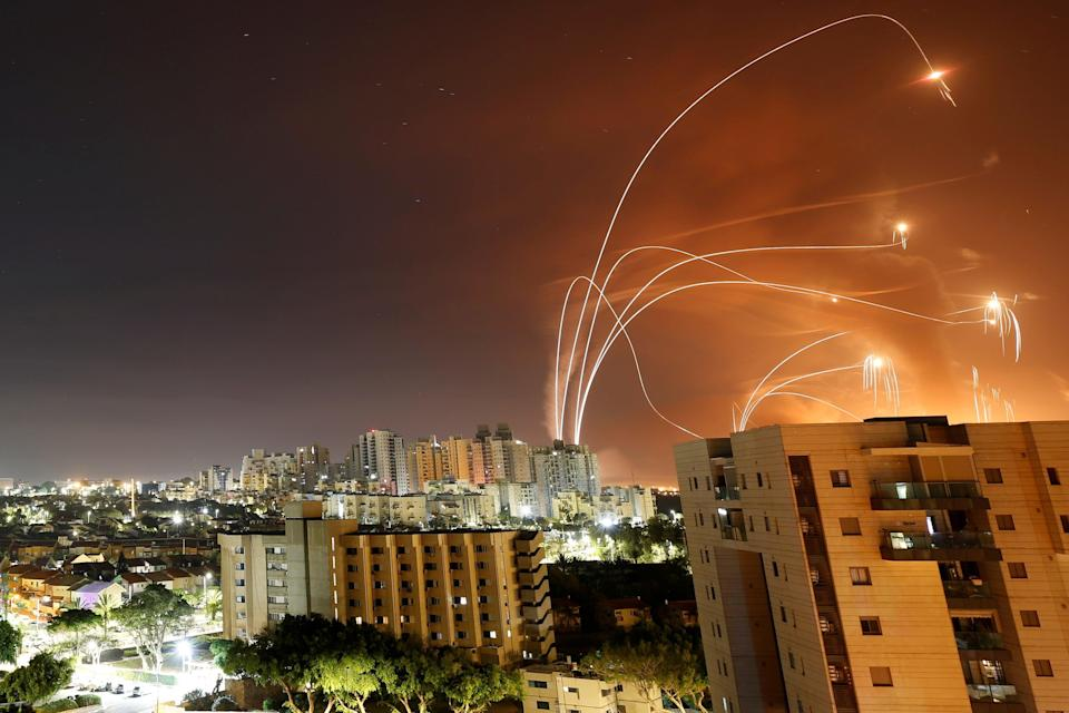 <p>Streaks of light are seen as Israel's Iron Dome anti-missile system intercept rockets launched from the Gaza Strip</p> (REUTERS)